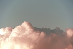 abstract unreal peachy colour cumulus clouds
