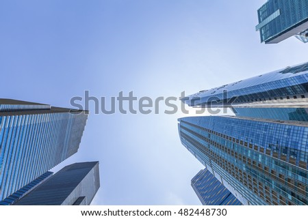 Abstract up view of skyscrapers with blue sky in Singapore downtown. Business and finance headquarters. Sun reflecting in the glass buildings. #482448730