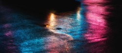 Abstract urban background. Lights and shadows of New York City. NYC streets after rain with reflections on wet asphalt.