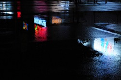 Abstract urban history, Lights and shadows, streets after rain with reflections on wet asphalt., horizontal image with blurred background, free space for text, defocus blurred