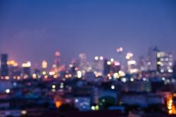 Abstract urban night light bokeh defocused background, city night