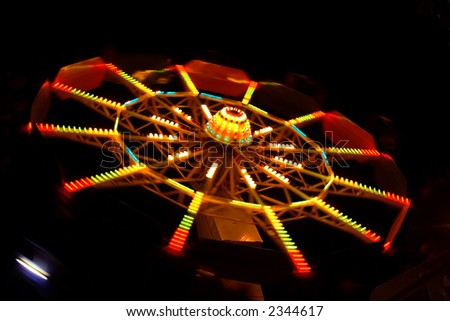 Abstract view of a colourful Ferris Wheel at night
