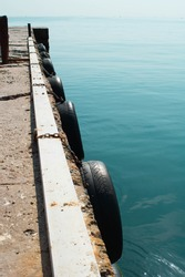 abstract view of a marina wooden pier in a shallow turquoise sea water.Sparse composition with lots of space