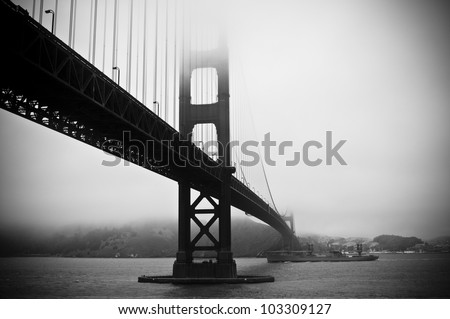 Abstract view of Golden Gate Bridge with battleship below