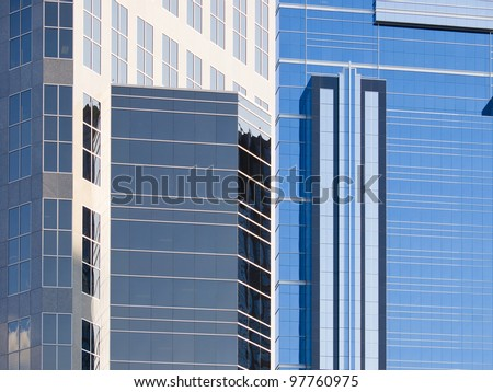 Abstract view of modern downtown skyscraper office windows. This is Calgary office building in downtown. Many Oil company\'s headquarters are in Calgary.
