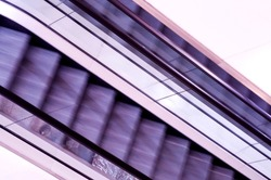 Abstract view of moving purple escalators