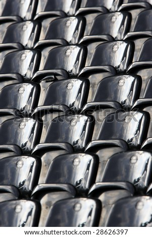 Abstract view of stadium seating in a large sports venue.