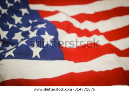 abstract vintage blurred crumpled retro american flag with vignette backgrounds : blur crumpled and creased fabric textures of American flag with vignette backgrounds.image