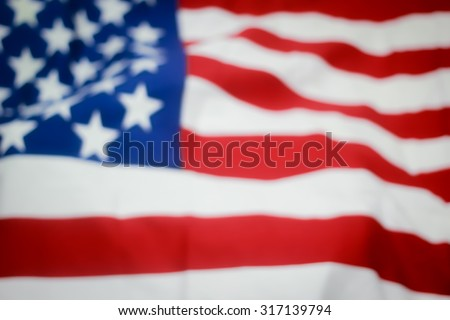 abstract vintage blurred crumpled retro american flag with vignette backgrounds : blur crumpled and creased fabric of American flag with backgrounds.independence day.patriotic concept.citizenship day