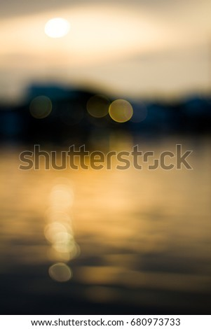 Abstract vintage bokey background, beautiful yellow bokey in the evening on river and city background
