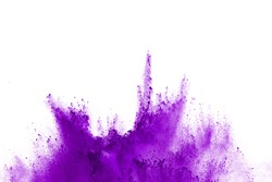 Abstract violet powder explosion. Closeup of violet dust particle splash isolated on white background