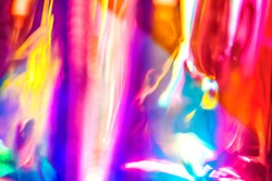 Abstract vivid wallpaper of holographic vertical lens flare neon lights with spectrum psychedelic saturated neon colors and shiny glowing reflections