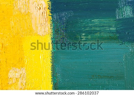 abstract wallpaper, texture, background of an original oil yellow and green painting on canvas with brush strokes.