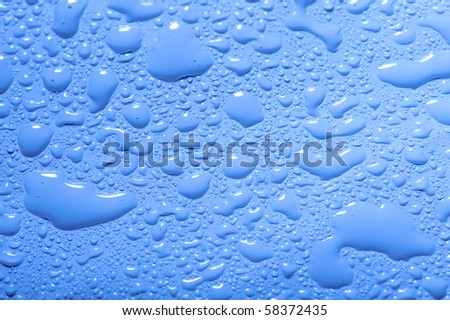 abstract water drops on plastic surface blue background