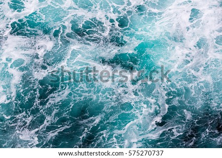 Abstract water image shows unique water movement that can be used for backgrounds or as a picture.  This surface ocean image has a unique texture and rich aqua colors.