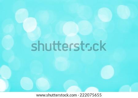 Abstract Water reflect light bokeh background. Light blue filter.