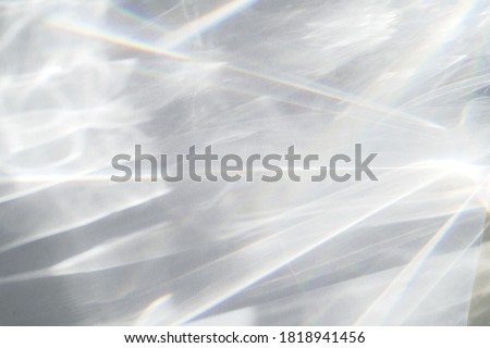 Abstract water texture overlay effect, rays of light  shadow overlay effect with rainbow reflection of light from water on a white background, mockup and backdrop Stockfoto ©