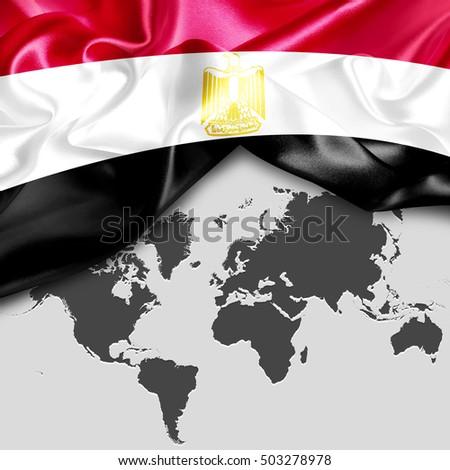 Abstract waving Egypt flag over world map #503278978