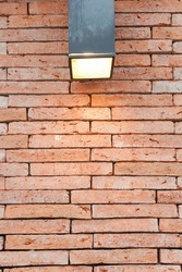 Abstract weathered textured red brick wall background with Lamp. Brickwork stonework interior, rock old clean concrete grid uneven, horizontal architecture wallpaper.