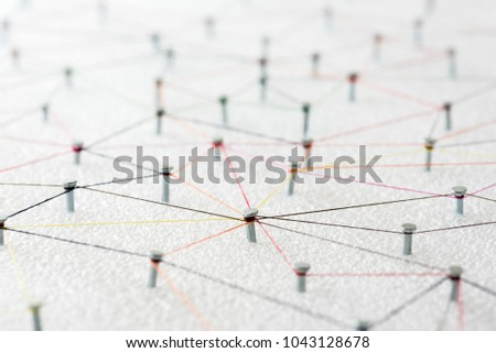 abstract web line connection of color yarn from nail node to node on white background , networking concept