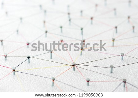abstract web line connection of color yarn from nail node to node on white background , networking concept #1199050903