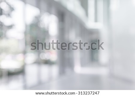 Abstract white blur background from building hallway corridor