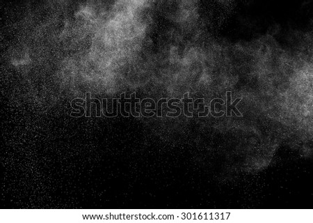 abstract white dust explosion  on a black background. #301611317
