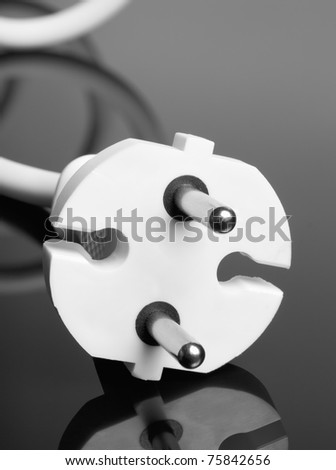 Abstract white europe standard power plug over black background. Copy-space.