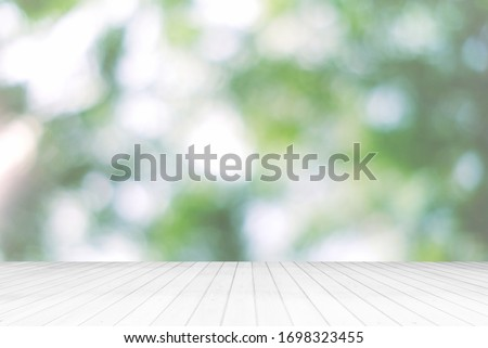 Abstract White Wooden Floor with Beautiful Bokeh in the Garden Background. stock photo