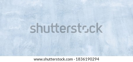 Abstract Wide Angle light blue stucco Background. Wall building Close up. Rough Surface plaster Texture With Copy Space for design
