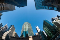 Abstract wide angle view of the urban skyline of Park Avenue in Midtown Manhattan, New York City under bright blue sky