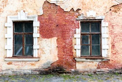Abstract windows in ruined and abandoned house