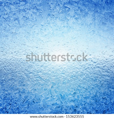 Abstract winter background - frozen water, ice on glass, bright sunlight #153623555