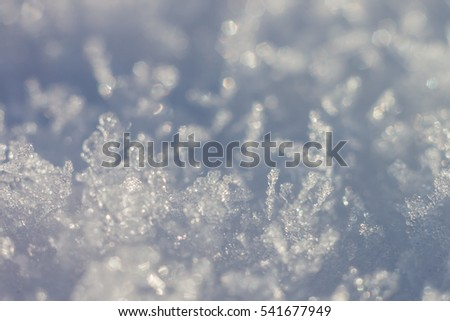 Abstract winter background. Snow crystals. The small depth of field. #541677949