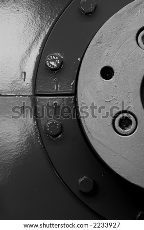 Abstract with bolt-heads. Black and white photo.
