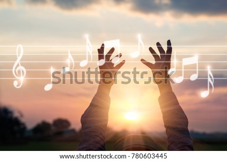 Abstract woman hands touching music notes on nature background, music concept #780603445