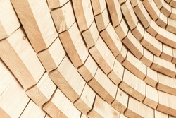 Abstract wooden background texture, round wall structure, close-up photo with selective focus