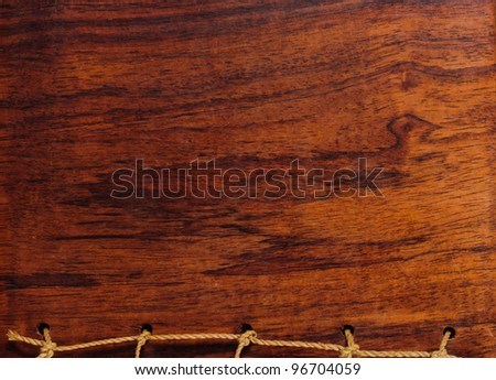 Abstract wooden background with rope