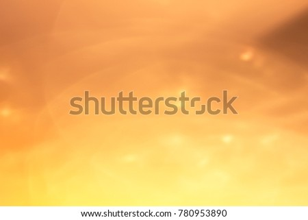 Abstract xmas Gold sparkles or glitter lights. Christmas festive gold background. Defocused lines bokeh or particles. Template for design #780953890