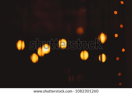 Abstract yellow bokeh background. Bokeh urban blurring colours concept. Night life of a big city. Lounge bar. Blur or defocus image of coffee shop or cafeteria for use as background. #1082301260