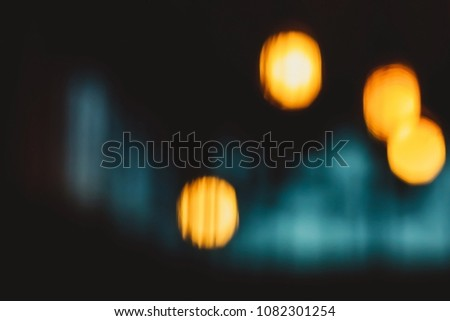 Abstract yellow bokeh background with free space. Bokeh urban blurring colours concept. Night life of a big city. Lounge bar. Blur or defocus image of coffee shop or cafeteria for use as background. #1082301254