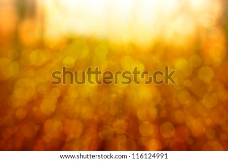 abstract yellow bokeh background with lens flare