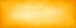 Abstract yellow brown orange background. Toned cement rough plaster wall texture. Bright wide banner. Panorama. Autumn, Thanksgiving, Halloween concept background. Copy space.