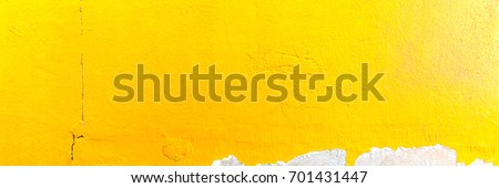 Abstract yellow cement wall texture and background