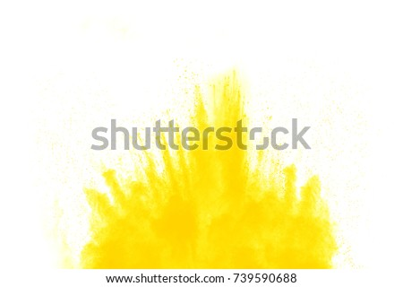 abstract yellow powder explosion on  black background.