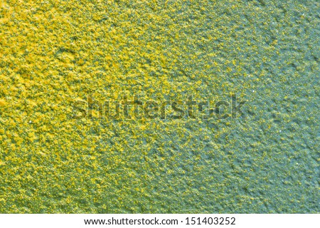 Abstract yellow splashes on green background texture