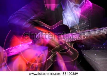 Abstract zoomed guitar and performer hand on stage