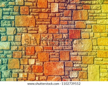 Abstraction of decorative stone,Decorative stone wall. Processing in retro style or vintage for design and creativity #1102739552