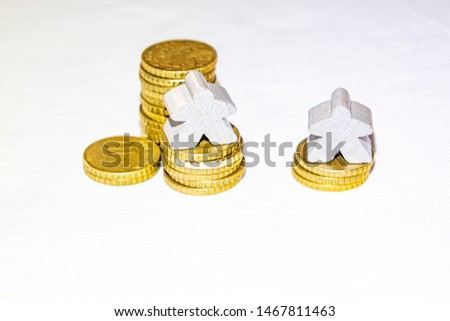 abstraction of poverty with piles of euro cents and wooden figur #1467811463