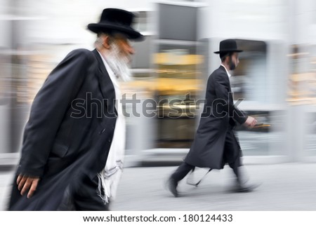 abstrakt image of Jewish business people in the street and modern style with a blurred background
